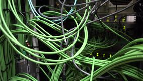 Green cable. Big server rack. Motion camera. Green cable. Big server rack. Motion camera stock footage