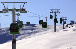 Green cable cars in Europe, in winter royalty free stock images