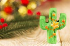 Green cactus toy on christmas background Stock Image