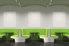 Green cafe interior with sofas and posters, side Royalty Free Stock Photo