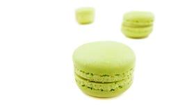 Green cake macaron on white background, maccarone sweet dessert Stock Photo