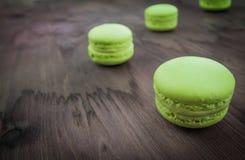 Green cake macaron on wood background, maccarone sweet dessert Royalty Free Stock Images