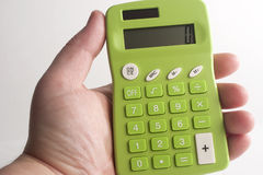 Green Calculator. Hand holding green calculator with buttons royalty free stock photo