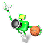 The green camera character holding a basketball running. Create Stock Photo