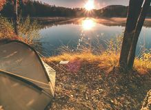 Free Green Camping Tent At Lake In Early Morning Stock Photos - 135898123