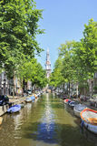 Green canal with ancient houses, Amsterdam. Royalty Free Stock Photography