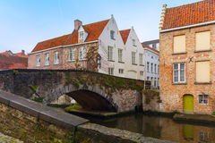 Green canal and bridge in Bruges, Belgium Royalty Free Stock Photos