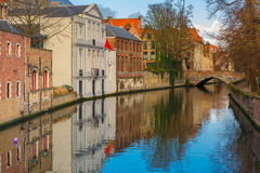 Green canal and bridge in Bruges, Belgium. Scenic cityscape of the Green canal, Groenerei, and bridge in Bruges, Belgium Stock Images