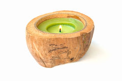 Green Candle in a coconut shell Stock Photo