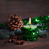 Green candle with decoration Stock Photos