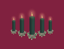 Green Candle Display on Red Stock Images