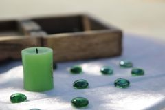 Green candle and esotericism stock photos
