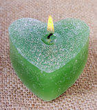 Green candle and flame. Stock Photography