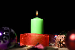 Green candle lightened Stock Photography