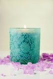 Green Candle and Sea Salt - Side View. Green candle with purple aromatic sea salt Stock Photo