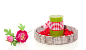 A green candle in a tray Royalty Free Stock Image