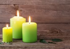 Green candles on dark wooden background Stock Image