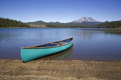 Green canoe on a lake shore Royalty Free Stock Image