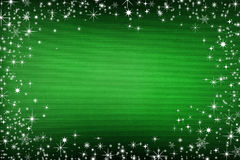 Green canvas background with snow and stars Stock Photos