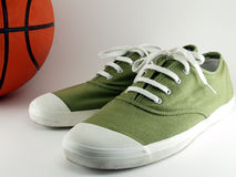 Green Canvas shoes with basketball Royalty Free Stock Images