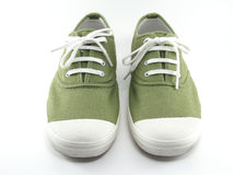 Green sneakers isolated on white background Stock Images