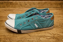 Green canvas sneakers Royalty Free Stock Images