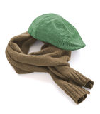 Green cap and brown warm scarf. On a white background royalty free stock photos