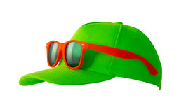 Green cap and orange sunglasses Stock Photography