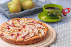 Green Cap of Tea and Homemade Pears Pie with Cranberry and Pears. In the Wooden Box  on the Wooden background Royalty Free Stock Photo