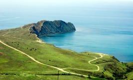 Green cape. And blue sea Stock Photo