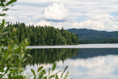 Green cape on lake. Tagasuk lake Royalty Free Stock Photos