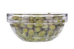 Green capers in a glass bowl. Stock Photo