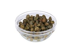 Green capers in a glass bowl. Stock Images
