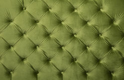 Green capitone tufted fabric upholstery texture. Green velvet capitone textile background, retro Chesterfield style checkered soft tufted fabric furniture Stock Image