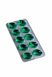 Green capsules. Royalty Free Stock Images
