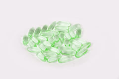 Green capsules / pills with fish oil omega 3 Stock Image