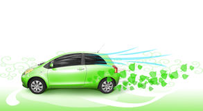 Green car. A small ecological economical green car moves forward with fresh green leaves flowing behind. Concept for environmental low carbon emitting vehicle