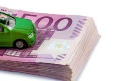 Green car on banknotes royalty free stock image