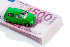 Green car on banknotes. Green model car on banknotes, symbolic photograph for car purchase, financing and costs royalty free stock image