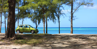 Green car on beach Royalty Free Stock Image