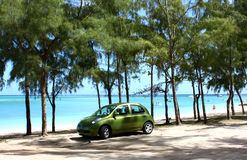 Green car on beach Royalty Free Stock Photos