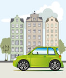 Green car in the city Royalty Free Stock Photos