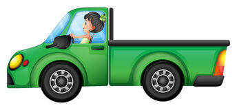 A green car driven by a girl Royalty Free Stock Images