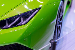 Green car in the exhibition room at the light sensitivity. Green car in the exhibition room at the light sensitivity in Mega store Royalty Free Stock Photo