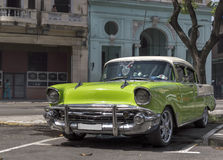 Green car in Havana, Cuba. Vintage car parked in Havana, Cuba stock image