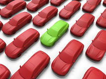 Green car inside a crowd of red cars Royalty Free Stock Photography