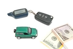 Green car, keys and money on white Stock Photography