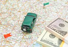 Green car on map with money Stock Photos