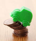 Green car miniature over pennies Stock Photo