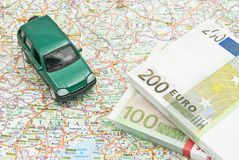 Green car and money on map Stock Images